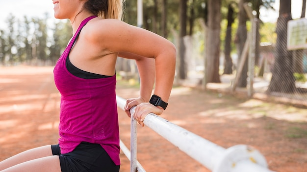 Sporty woman working out on stadium track