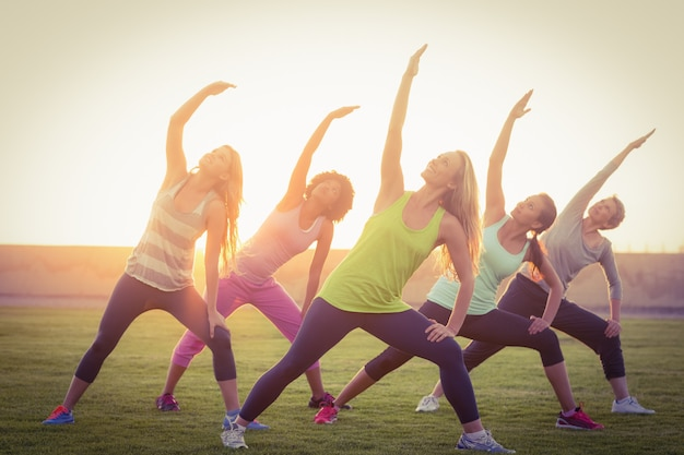 Sporty women warming up during fitness class