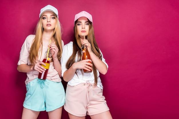 Sporty women with drinks