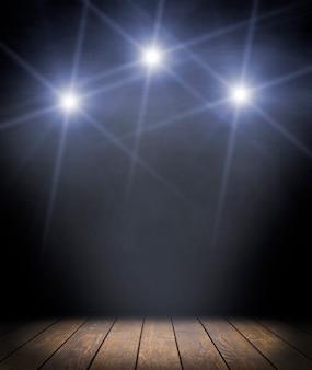 暗い背景と木の床の上のスポット照明。コンサート