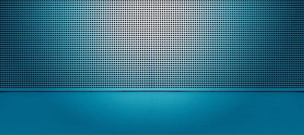 Точечная подсветка перфорированной металлической пластины синего цвета. металлический фон крупным планом