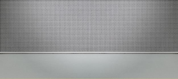 Точечная подсветка перфорированной металлической пластины. металлический фон крупным планом
