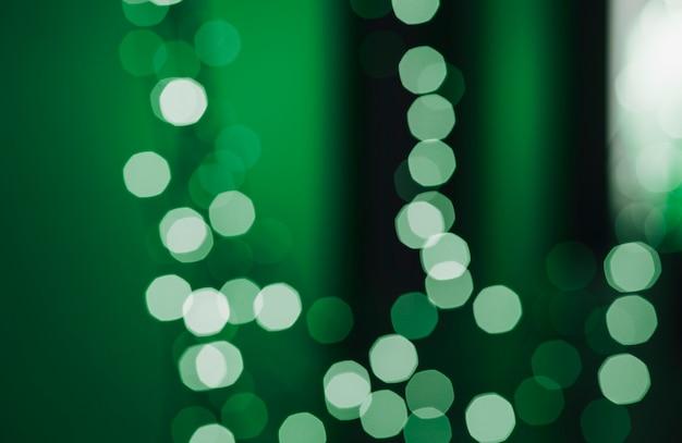Spots of light on green