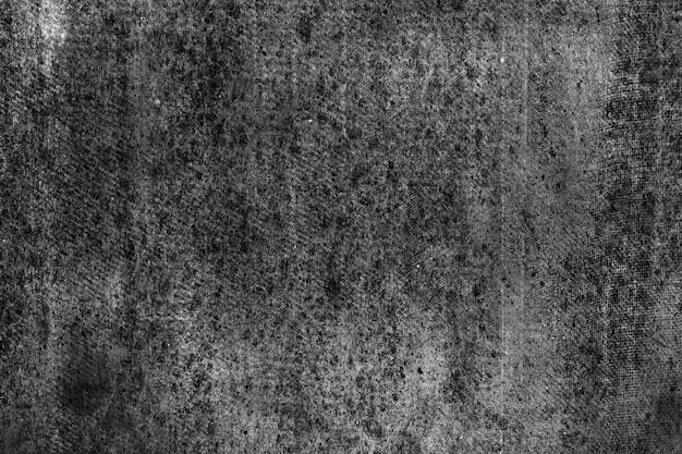 壁の斑点。抽象的な黒の背景。黒漆喰の質感。暗い粗面。
