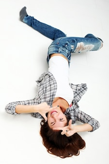 Sprawl girl in studio and look at camera