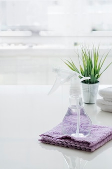 Spray bottle and towel on the table.