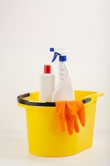 Spray bottles in bucket front view