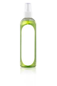 白い背景で隔離のラベルのない緑色の液体でボトルをスプレー
