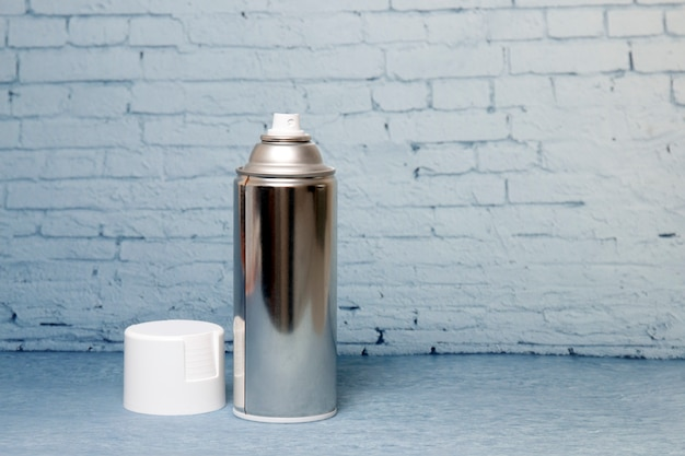 Spray can on a blue background