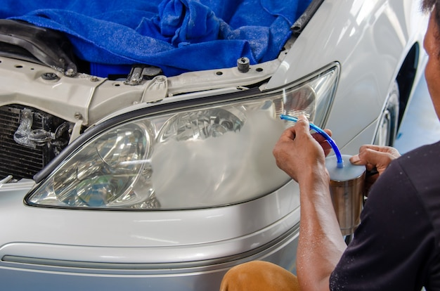 Spray lacquer to coat the car headlights to make them shine.