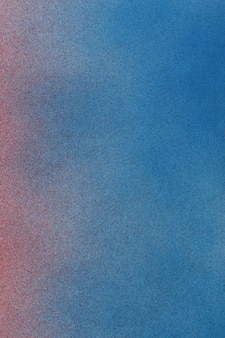 Spray paint gradient from red to blue on a white paper background