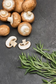 Sprig of rosemary and champignons