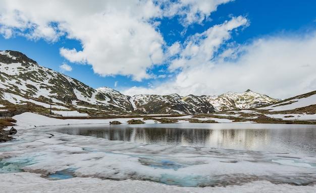 Spring alps mountain lake lago della piazza (switzerland, passo del san gottardo)