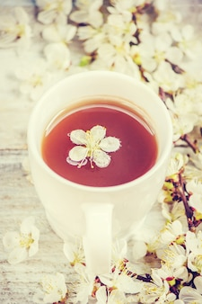 Spring background, flowers and tea. selective focus.