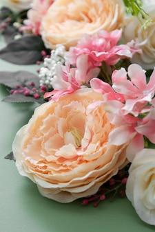 Spring background, vintage flower composition on green board. festive frame or border, copy space.