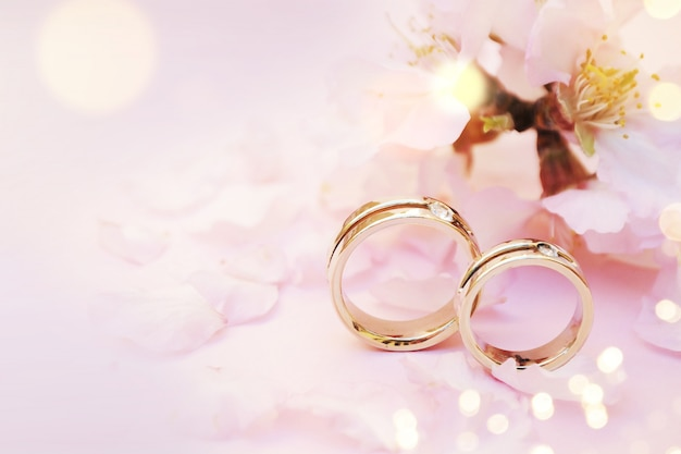 Spring background with blossom and wedding rings