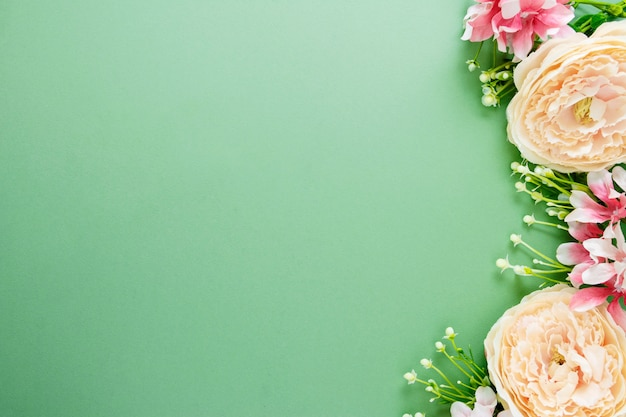 Spring background with flower composition. festive frame or border. top view with copy space.