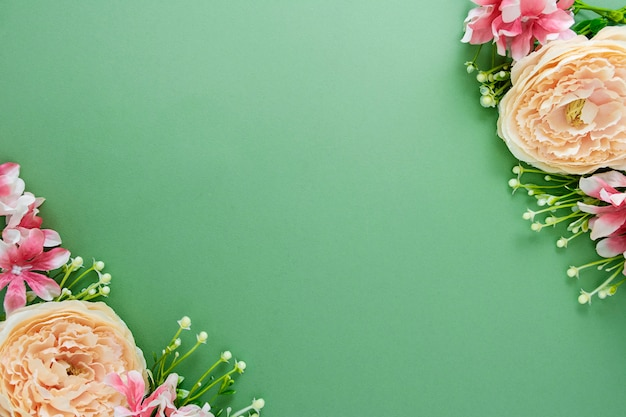 Spring background with flower composition on green board. top view with copy space.