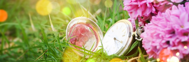 Spring background with pocket clock
