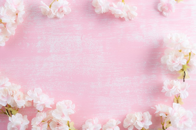 Spring blooming branches on pink wooden background