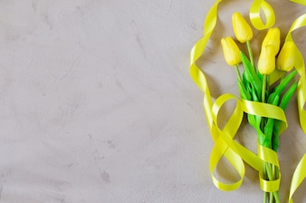 Spring bouquet of yellow tulips with ribbon.