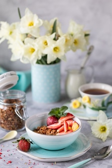 Spring breakfast with flowers, cheesecakes and fresh berries