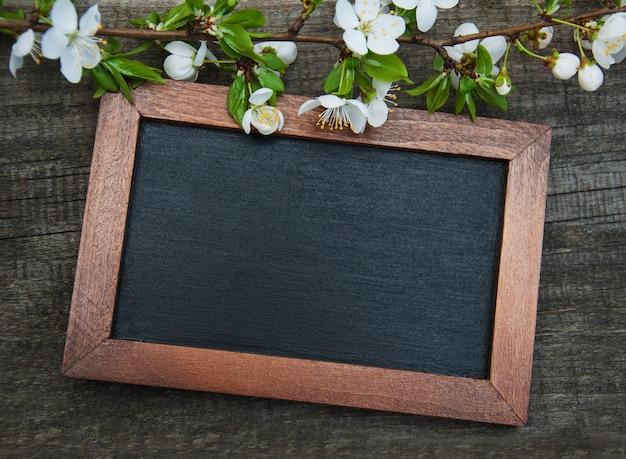 Spring cherries blossom and blackboard