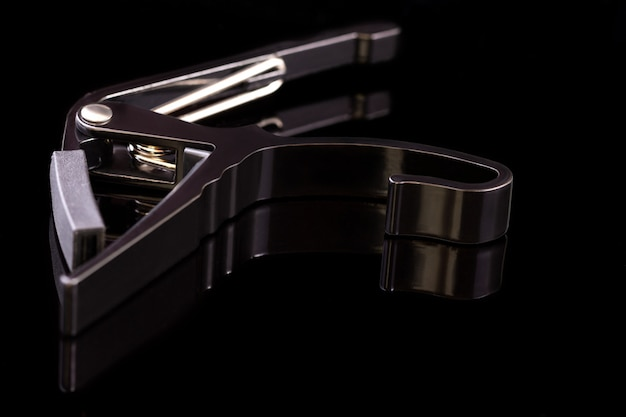 Spring clamp capo on black