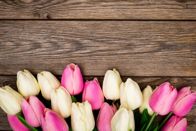 Spring composition with tulips on wooden