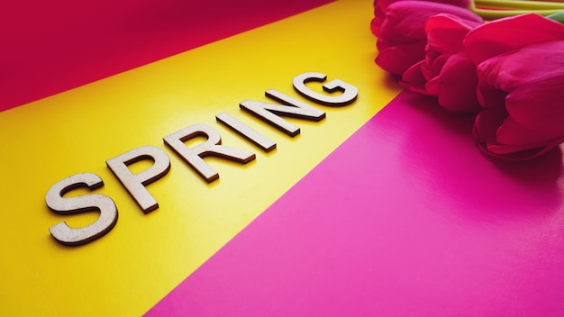 Spring concept. bouquet of tulips on colorful background. mothers day or 8th of march festive theme. close-up with text spring. spring sale banner