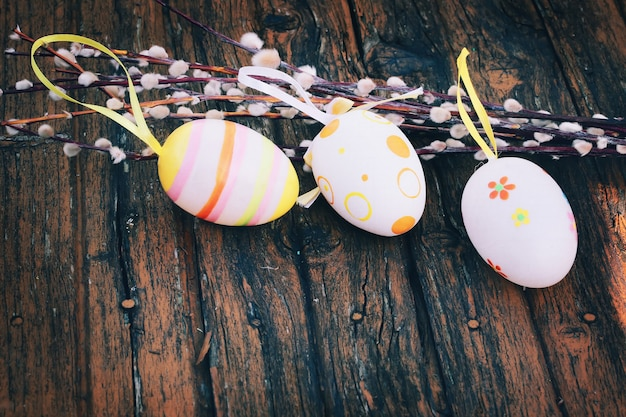 Spring easter background easter eggs willow selective soft focus rustic retro style