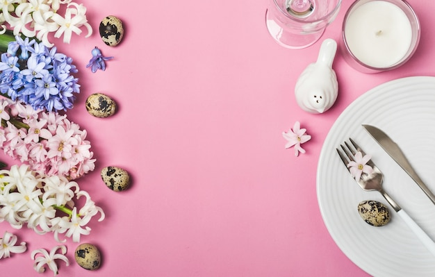 Spring easter table setting with hyacinth flowers on pink