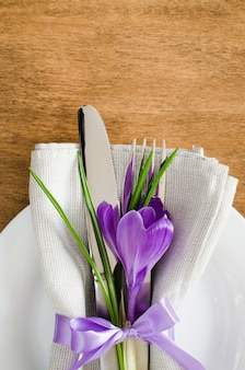 Spring festive table setting with fresh flower.