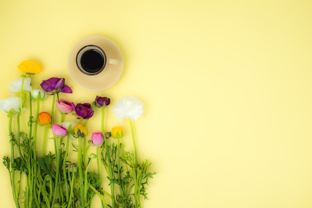 Spring flatlay concept background with flowers and cup of coffee