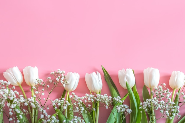 Spring flower arrangement on a pink wall