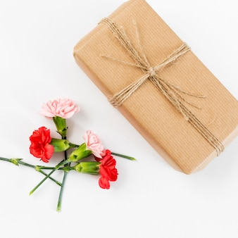 Spring flowers background with present box