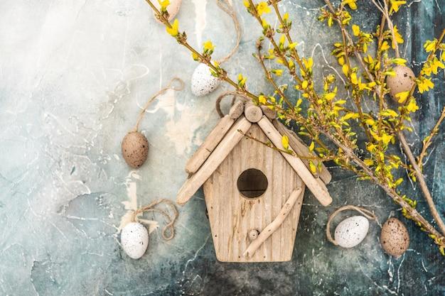 Spring flowers easter eggs decoration forsythia birdhouse