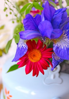 Spring flowers in a teapot