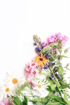Spring flowers on a white wooden background