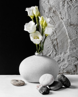 Spring flowers with a bunch of rocks arrangement Free Photo