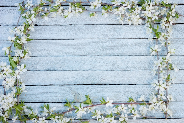 Spring flowers on wooden table background.
