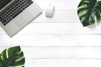 Spring Leaf on White Wood Background with Laptop ,Office Desk - Flat Lay Style