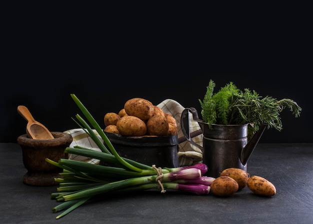 Spring onions and potatoes