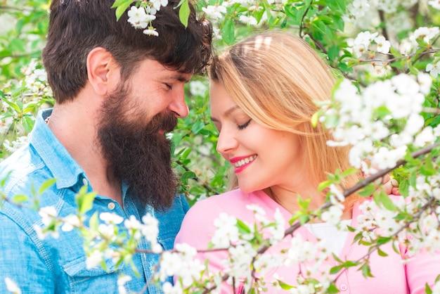 Spring outdoor portrait of beautiful happy couple walking in park.