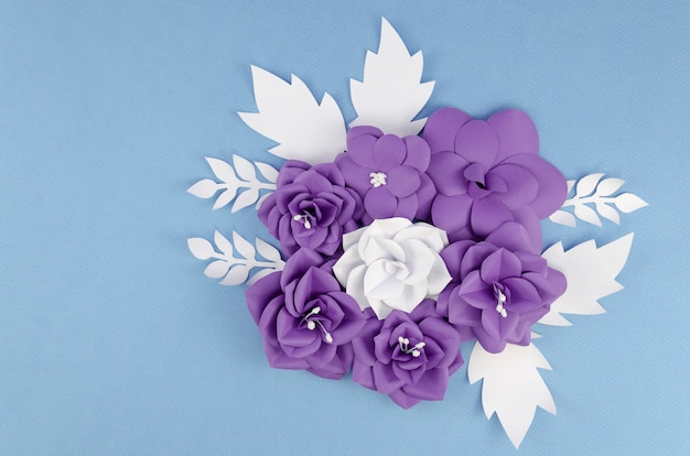 Spring paper flowers on blue background