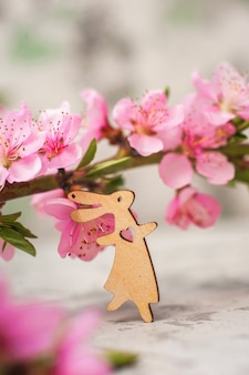Spring photo of a blossoming tree and bunnies close-up and copy space.