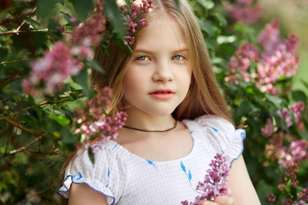 Spring portrait of a child in park. funny emotions