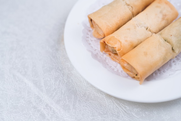 Spring roll also known as egg roll isolated on white.