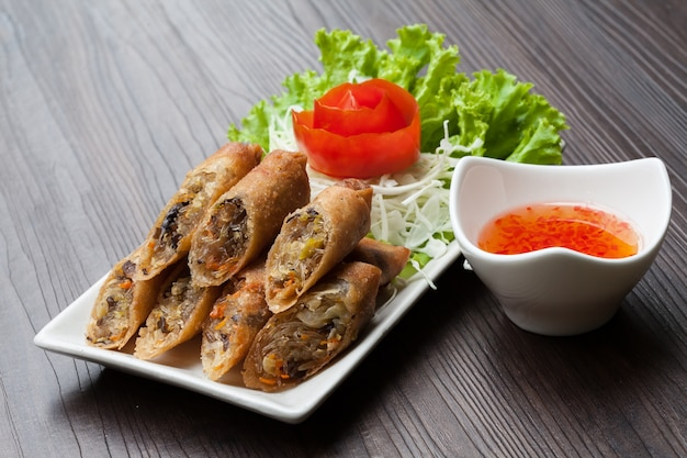 Spring rolls in a dish on a table