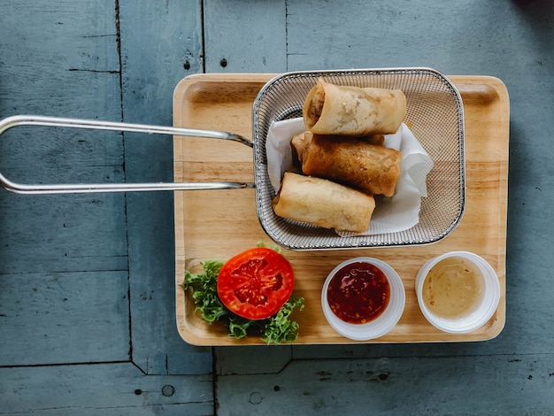 Spring rolls on rustic wooden table